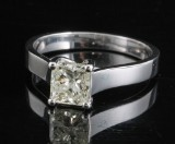 Ring in 18k set with a square emerald cut diamond  1.05 ct <br>