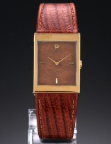 Rolex 'Cellini'. Men's watch in 18 kt. gold with 'wood' dial, around 1991