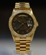 Rolex Day Date, men's watch, 18 kt gold with diamonds
