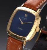 Rolex 'Cellini'. Stort dameur i 18 kt. guld med blå skive, ca. 1980