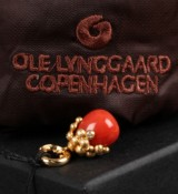 Ole Lynggaard. 'Sweet Drops' charm, 18 kt. red gold with coral and diamonds