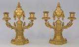 Ett par kandalabere i brennforgylt bronse.(2)