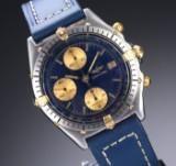 Breitling 'Chronomat'. Herrechronograf i 18 kt. guld og stål med blå skive, 1990'erne