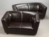 Ukendt møbelproducent. Tre og to pers. sofa betrukket med brunt læder. (2).