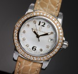 Carl F. Bucherer 'Patravi'. Ladies watch, 18 kt. gold and steel with diamonds and mother of peral dial, 2000s