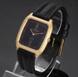 IWC men's watch, 18 kt. gold case, black dial