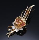 Diamant- og rubin hattenål/broche af 18 kt. guld og hvidguld