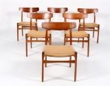 Hans J. Wegner. A set of six chairs, oak frame with teak toprail. model CH-23 (6)