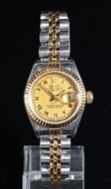 Rolex 'Datejust'. Dameur i 18 kt. guld og stål, certifikat fra 1991