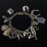 14 kt. guld armbånd med charms