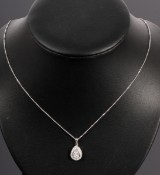Mystery Collection. Brilliant-cut diamond pendant, 14 kt. rhodium-plated gold, 0.33 ct.