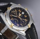 Breitling 'Chronomat'. Herreur i 18 kt. guld og stål med sort skive, 1990'erne