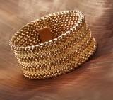 Gori & Zucchi, Arezzo. A wide bracelet, 18 kt. gold, 1950s
