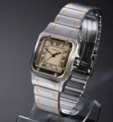 Cartier 'Santos Galbée'. Men's watch in 18 kt. gold and steel with date, 1990s