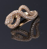 Ole Lynggaard. A small 'Snakes' ring, 18 kt. red gold with diamonds, total 1.24 ct.