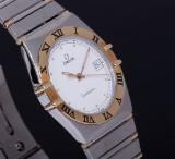 Omega men's watch, model Constellation. 18 kt. gold/steel, date
