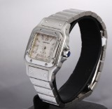 Cartier 'Santos'. Ladies watch, steel with guilloche dial with date, new model
