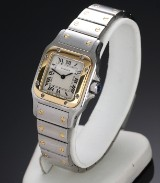 Cartier 'Santos Lady'. Ladies watch in 18 kt. gold and steel with light dial, c. 1990s