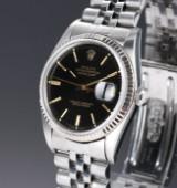 Rolex 'Datejust'. Herrenuhr aus Stahl mit schwarzem Zifferblatt und Datum, ca. 1984
