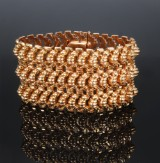 Wide bracelet, 18 kt. gold. Weight approx. 99.5 g. W. 4.8 cm