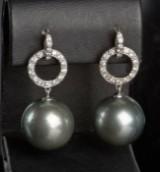 Tahitian pearl earrings featuring brilliant-cut diamonds