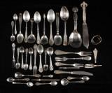 Samling bestikdele af sølv (38)