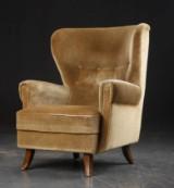 Øreklapstol med vippefunktion, dansk møbelproducent