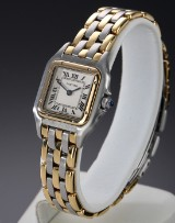 Cartier 'Panthère'. Ladies' watch in 18 kt. gold and steel with bright dial, 1990s