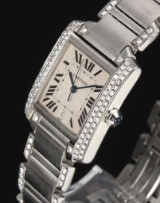 Cartier 'Tank Francaise'. Unisex watch in steel with diamond bezel and bracelet