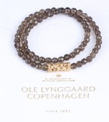 Ole Lynggaard. 'Lace' clasp, 18 kt. gold, with smoky quartz necklace  (2)