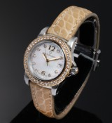 Carl F. Bucherer 'Patravi'. Ladies watch, 18 kt. gold and steel with diamonds and mother of pearl dial