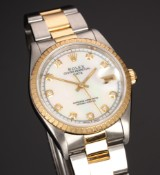 Rolex Date. Men's watch, 18 kt. gold and steel with mother of pearl dial set with diamonds, certificate 1998