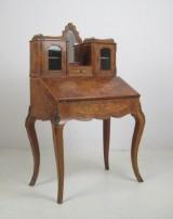 A top piece bureau, early 19th century
