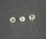 3 lose Diamanten, ca. 0.62 ct.