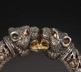 Panter brillant- og diamantarmring af guld og sølv, i alt ca. 12.00 ct