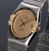 Omega 'Constellation'. Men's watch, 18 kt. gold and steel with date, c. 1991