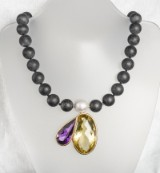 Agate necklace featuring amethyst, citrine, and South Sea pearl in gold setting