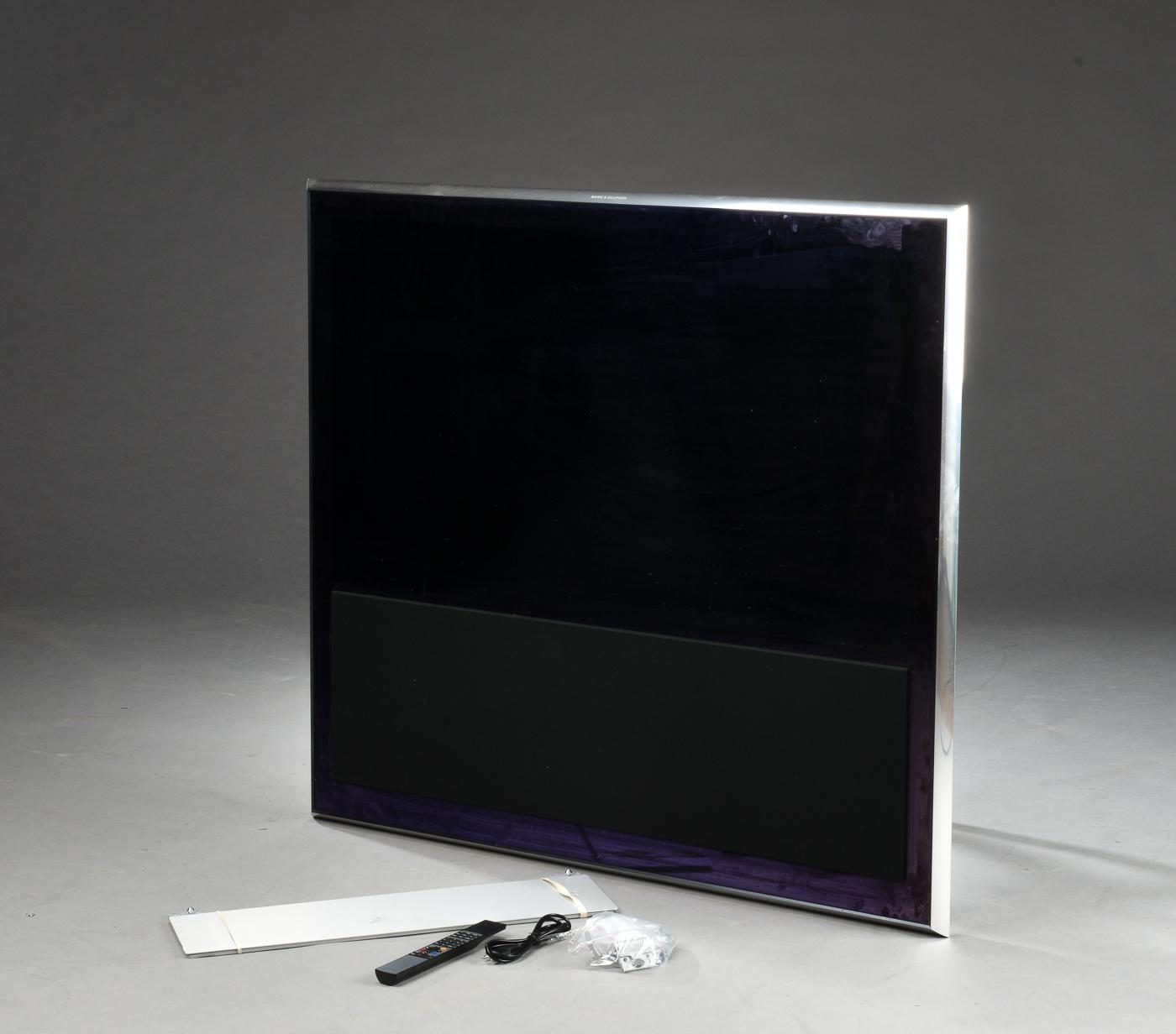 Bang & Olufsen. BeoViosion 10-46 samt Beo4 fjernbetjening - Bang & Olufsen. BeoVision 10-46, fladskærms TV med HDMI indgange. Vægbeslag, Beo4 fjernbetjening og ledning medfølger. Efterset på autoriseret B&O, seks måneders garantibevis medfølger. Lauritz.com indestår ikke for funktionaliteten