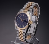Rolex Datejust. Men's watch, 18 kt. gold and steel, 1989