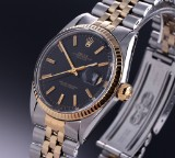 Rolex 'Datejust'. Vintage men's watch, 18 kt. gold and steel, with black dial, c. 1970