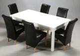 Dansk Møbelproducent. Spisebord af træ med 6 stole beklædt med sort skind. (9).