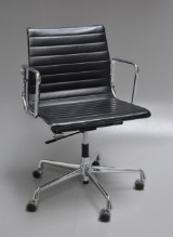 Charles Eames. Office chair with black leather, model EA117