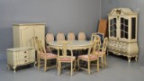 Dining suite, painted and parcel-gilt wood, with assorted tablecloths (21)