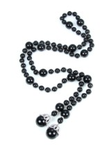 Tie necklace with onyx and numerous brilliant-cut diamonds