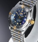 Breitling 'Callistino'. Dameur i 18 kt. guld og stål med blå skive - cert. 2004