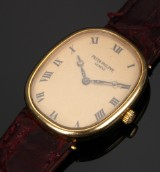 Patek Philippe 'Ellipse'. Vintage ladies watch, 18 kt. gold with champagne-coloured dial