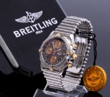 Breitling Chronomat. Men's watch, 18 kt. gold and steel with black dial