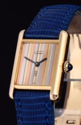 Cartier 'Tank'. Ladies watch, gilt sterling silver with original strap and clasp