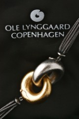 Ole Lynggaard. Fidelity clasp, 14 kt. gold and white gold, with silver chain