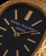 Patek Philippe 'Ellipse'. Vintage ladies watch, 18 kt. gold with blue dial